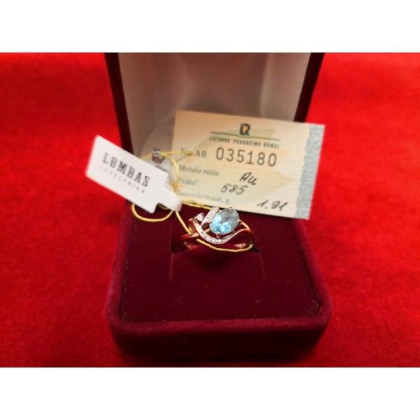 Auksinis žiedas su topazu.