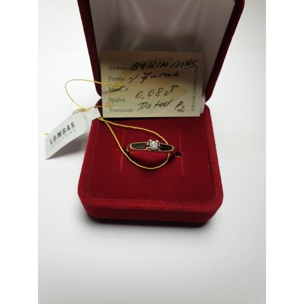 Auksinis žiedas su briliantu.